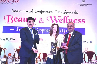 Dr. Majeed receiving the 'Legend of Natural Cosmeceuticals' award from Mr. Sandeep Marwah Chancellor, AAFT University of Media & Art and Her Excellency Ms. Jennifer Graham, Spouse of His Excellency Mr. Nadir Patel, Canadian High Commission of India